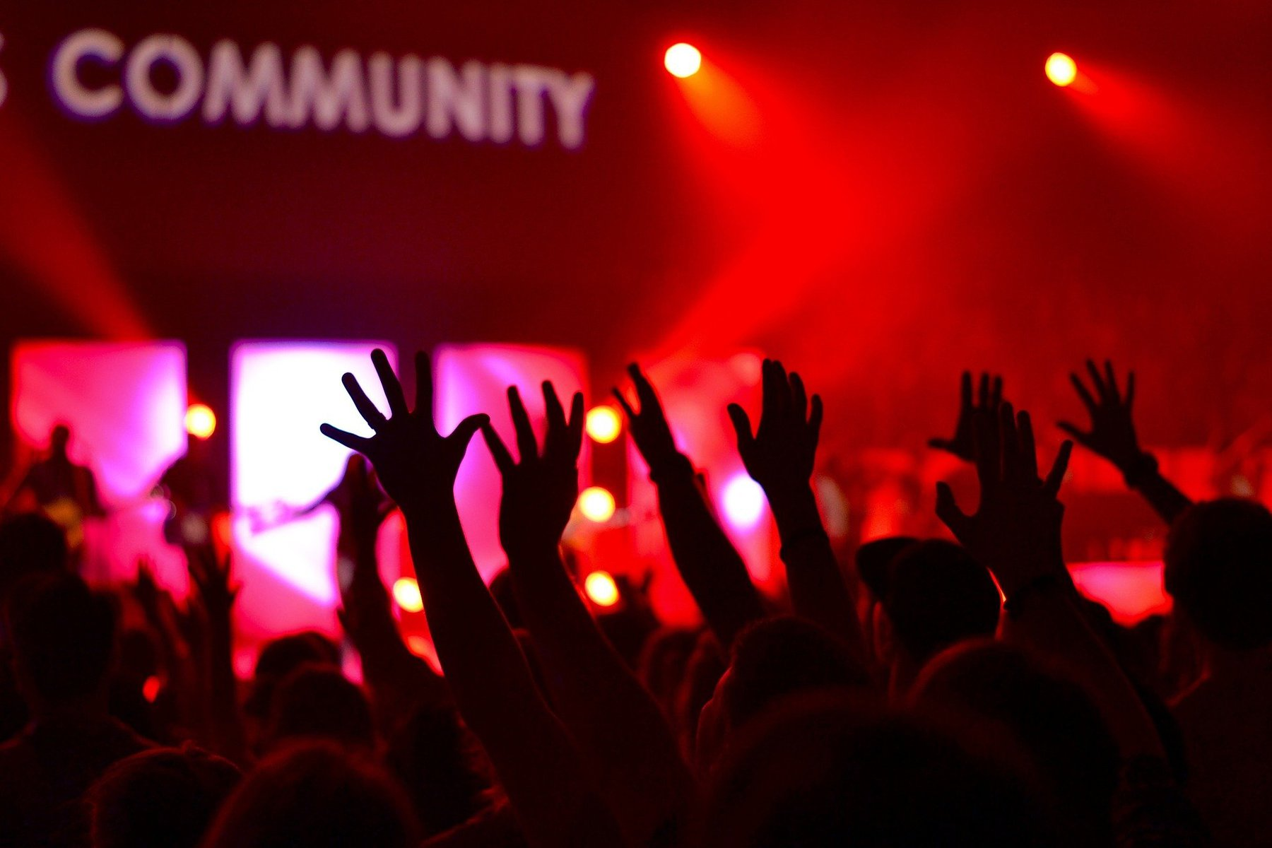 "A group of people at a concert with the word ""Community"" above them is used in reference to classroom community"